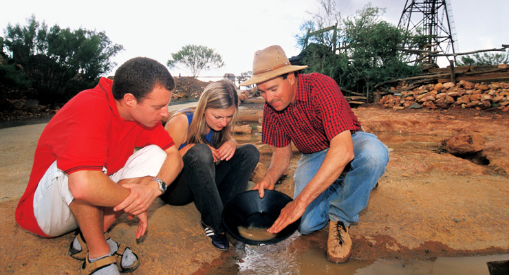 Three people panning for gold