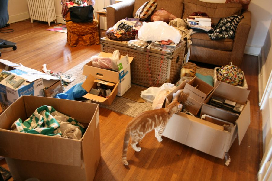cluttered living room filled with boxes