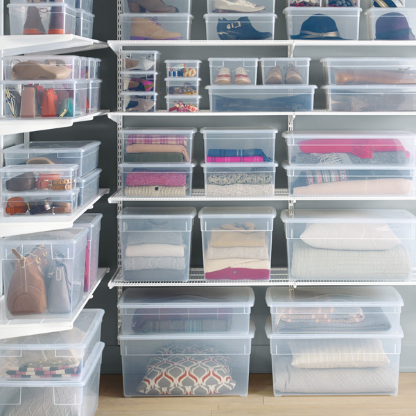 plastic storage boxes in room filled with household items