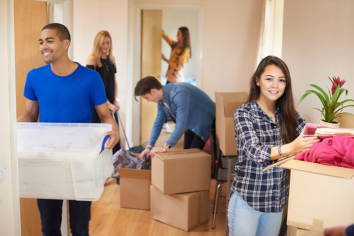 Five friends helping pack up a house